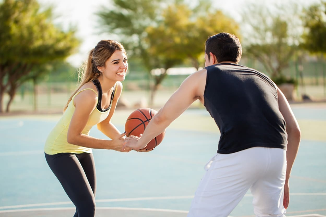 shutterstock_337684265-men-and-woman-bball.jpg